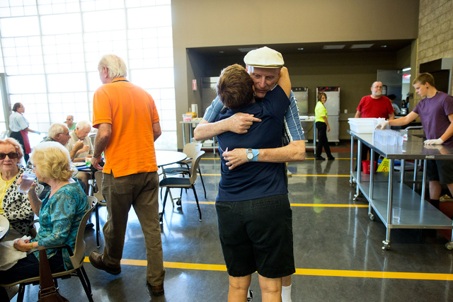 Bonnie Adams, dining room coordinator at Heritage Park Senior Facility, gives Jerry Hill a hug at the senior center Friday, June 20, 2014. The number of lunches served in the senior facility dropp ...