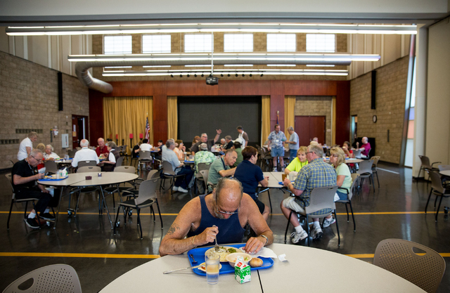 Sidney Vengrow (cq), center, eats lunch at the Heritage Park Senior Facility in Henderson on Friday, June 20, 2014. In an effort to reduce taxpayer costs, the suggested donation price for seniors  ...
