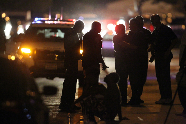 North Las Vegas police investigate the scene on Hassell Avenue near Lake Mead and Martin L. King boulevards where a 31-year-old man was shot and wounded Monday, June 2, 2014. The man suffered one  ...