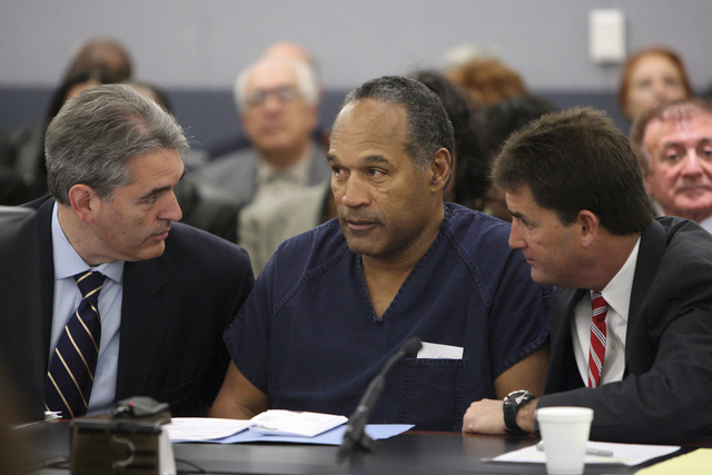 O.J. Simpson appears in court with attorneys Gabriel Grasso, left, and Yale Galanter prior to sentencing at the Clark County Regional Justice Center in Las Vegas on Dec. 5, 2008. (Issac Brekken/pool)