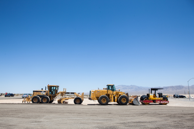Heavy equipment vehicles are seen at the site of the slated Skye Canyon master planned community, as the groundbreaking ceremony goes on in northwest Las Vegas, near U.S. Highway 95 and Horse Road ...