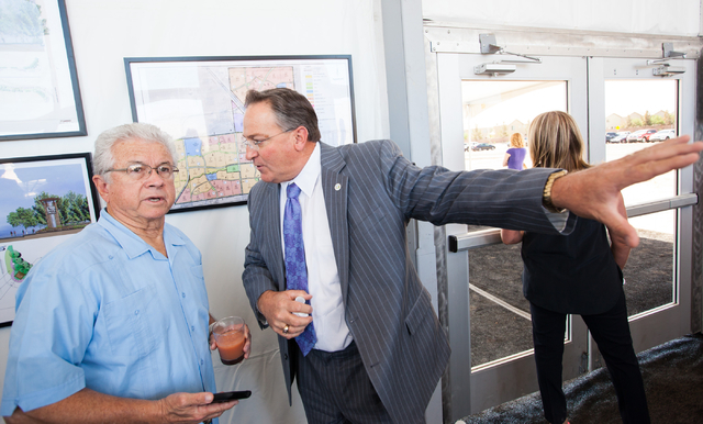 Las Vegas City Councilman Steve Ross, right, talks about the Skye Canyon master planned community with City Councilman Bob Coffin at the groundbreaking ceremony in northwest Las Vegas, near U.S. H ...