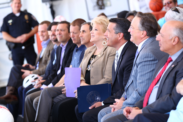 Public officials, including Las Vegas City Councilman Steve Ross, second from right, Gov. Brian Sandoval, third from right, and Las Vegas Mayor Carolyn Goodman, fourth from right, listen as Garry  ...