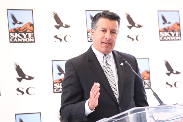Gov. Brian Sandoval speaks during the groundbreaking ceremony of the Skye Canyon master planned community in northwest Las Vegas, near U.S. Highway 95 and Horse Road, on Thursday, June 5, 2014. (C ...