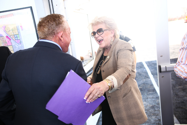 Garry Goett, CEO and chairman of Olympia Companies, which is the developer of the Skye Canyon master planned community, left, greets Las Vegas Mayor Carolyn Goodman during the groundbreaking cerem ...