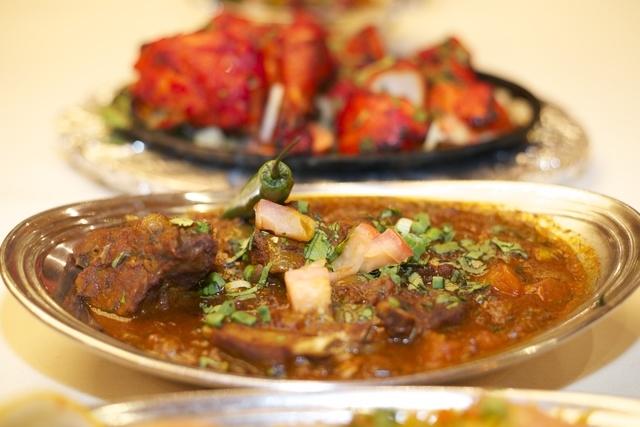 Lamb chop masala, front, and tandoori chicken are served at Royal India Bistro. (Courtesy photo)