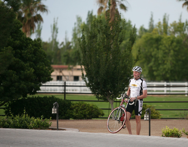 Kevin Burke, president and CEO of Burke Construction Group, retrieves his bike outside of his home Saturday, May 24, 2014, in Las Vegas. Burke is a hobby cyclist in his spare time in addition to l ...