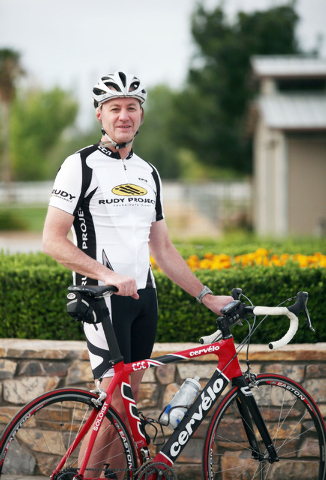 Kevin Burke, president and CEO of Burke Construction Group, stands outside of his home before riding his bike Saturday, May 24, 2014, in Las Vegas. Burke is a hobby cyclist in his spare time in ad ...