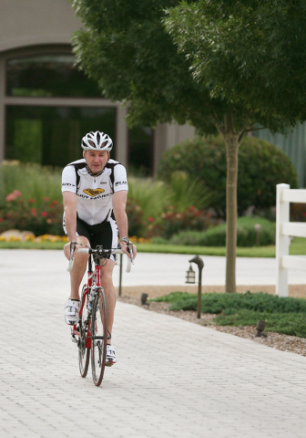 Kevin Burke, president and CEO of Burke Construction Group, rides his bike outside his home Saturday, May 24, 2014, in Las Vegas. Burke is a hobby cyclist in his spare time in addition to leading  ...
