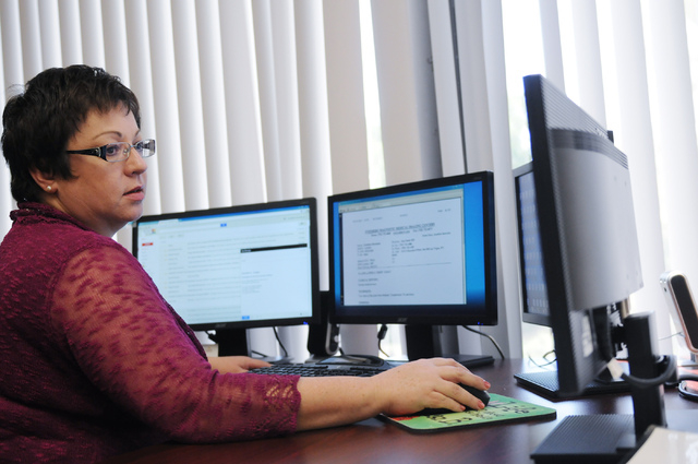 Annette Logan, president at Children's Specialty Center in Las Vegas, works at her office Monday, June 23, 2014. (Erik Verduzco/Las Vegas Review-Journal)