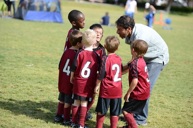 """Musbah Eldik coaches his son's soccer team, the Strikers, June 17 at The Crossings Park, 1111 Crestdale Lane. His wife, Lauren, said of Musbah, who is from Lebanon, """"(Soccer is) a huge part of ..."""