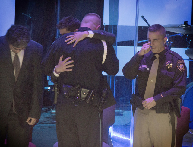 Robert Soldo, center, brother of Las Vegas police officer Igor Soldo,  hugs a friend during memorial service for his brother  at Canyon Ridge Christian Church,  6200 W Lone Mountain Road on Thursd ...