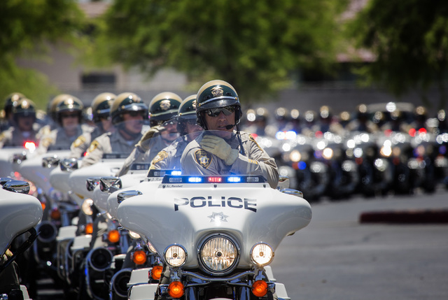 A motorcycle procession for  Las Vegas police officer Igor Soldo prepares to leave Canyon Ridge Christian Church,  6200 W Lone Mountain Road on Thursday, June 12, 2014.   Soldo and officer Alyn Be ...