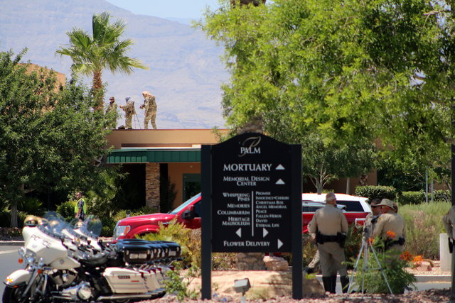 Police snipers prepare before funeral services for Las Vegas police officer Igor Soldo at Palm Northwest Mortuary & Cemetery in Las Vegas on Thursday, June 12, 2014. Soldo, 31, and fellow officer, ...