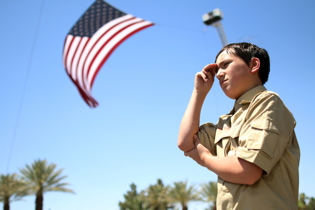 Boy Scout Benjamin Skankey, 12, salutes the procession during funeral services for Las Vegas police officer Igor Soldo at Palm Northwest Mortuary & Cemetery in Las Vegas on Thursday, June 12, 2014 ...