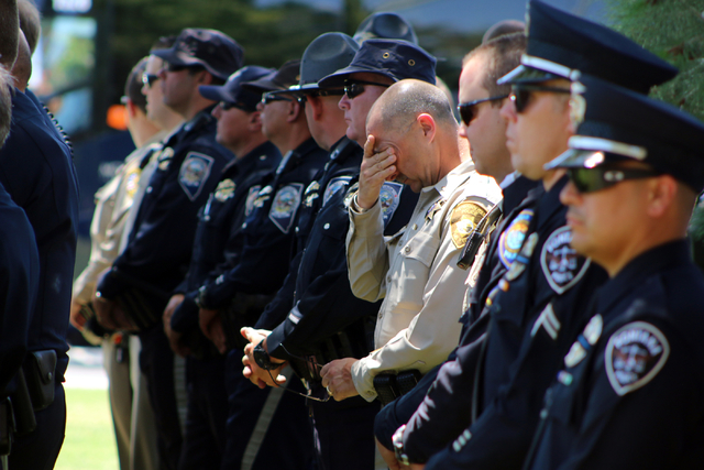 Law enforcement officers mourn at funeral services for Las Vegas police officer Igor Soldo at Palm Northwest Mortuary & Cemetery in Las Vegas on Thursday, June 12, 2014. Soldo, 31, and fellow offi ...