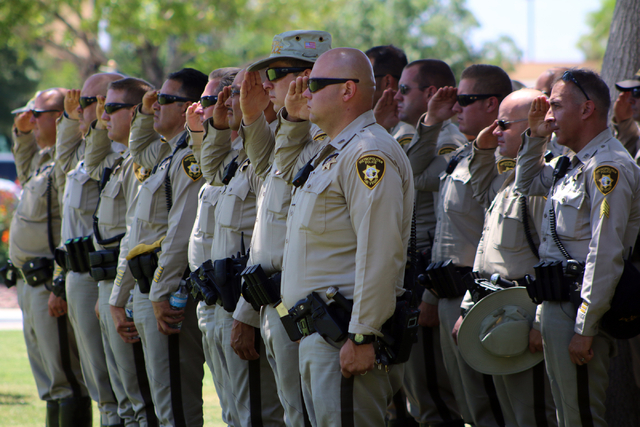 Law enforcement officers salute at funeral services for Las Vegas police officer Igor Soldo at Palm Northwest Mortuary & Cemetery in Las Vegas on Thursday, June 12, 2014. Soldo, 31, and fellow off ...