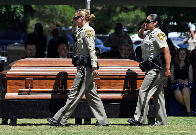 Las Vegas police file by the casket of Las Vegas police officer Igor Soldo during funeral services for him at Palm Northwest Mortuary & Cemetery on Thursday, June 12, 2014 in Las Vegas. Soldo, 31, ...