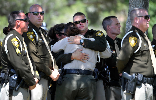 Las Vegas police officers console each during funeral services for Las Vegas police officer Igor Soldo at Palm Northwest Mortuary & Cemetery on Thursday, June 12, 2014 in Las Vegas. Soldo, 31, and ...