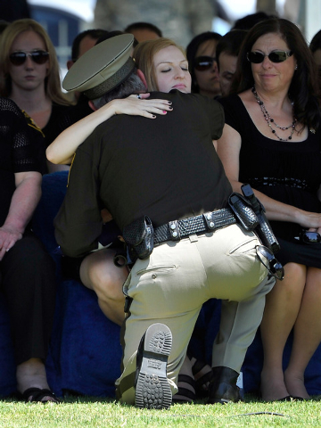 Las Vegas Sheriff Doug Gillespie hugs Andrea Soldo after receiving a flag during the funeral services for her husband and Las Vegas police officer Igor Soldo at Palm Northwest Mortuary & Cemetery  ...