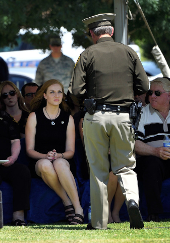 Las Vegas Sheriff Doug Gillespie approaches Andrea Soldo to presents a flag during the funeral services for her husband and Las Vegas police officer Igor Soldo at Palm Northwest Mortuary & Cemeter ...
