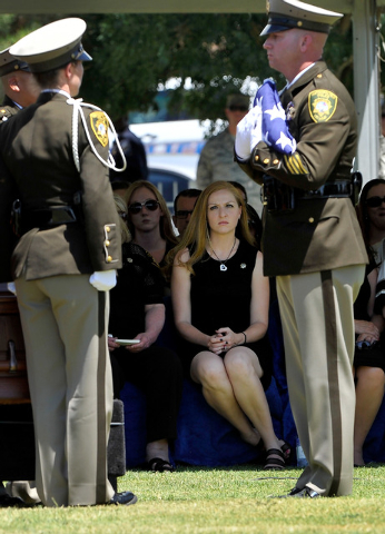 Andrea Soldo, center, watches the flag folding ceremony during the funeral services for her husband and Las Vegas police officer Igor Soldo at Palm Northwest Mortuary & Cemetery on Thursday, June  ...