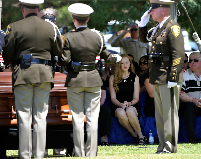 Andrea Soldo, second right, sits quietly as an American flag is folded during the funeral services for her husband and Las Vegas police officer Igor Soldo at Palm Northwest Mortuary & Cemetery on  ...