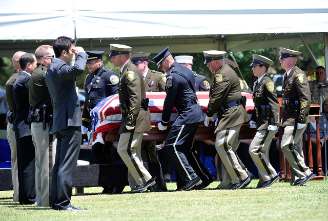 Police honor guard members carry the casket of Las Vegas police officer Igor Soldo for his funeral at Palm Northwest Mortuary & Cemetery on Thursday, June 12, 2014 in Las Vegas. Soldo, 31, and fel ...