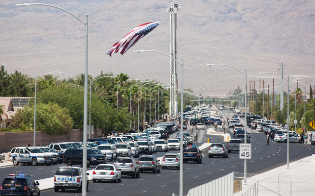 The funeral procession for fallen Las Vegas police officer Igor Soldo arrives at Palm Northwest Mortuary & Cemetery in Las Vegas on Thursday, June 12, 2014. (Chase Stevens/Las Vegas Review-Journal)