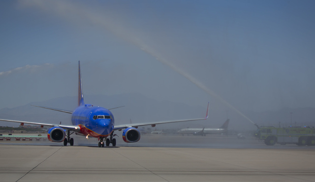 Southwest Airline  piloted by  Capt. Fred Sorenson gets a ceremonial retirement spraying  at  McCarran International Airport on Wednesday, June 11 , 2014.  Sorenson, known  ҊockӠin the ...