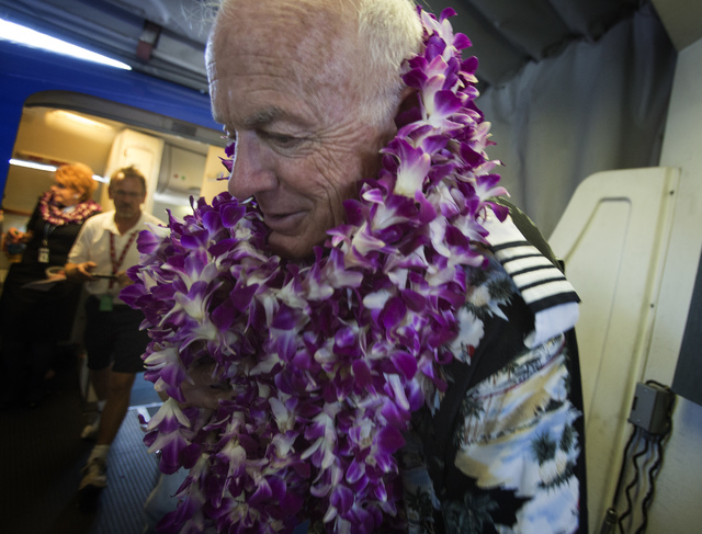 Southwest Airline  pilot Capt. Fred Sorenson leaves the cockpit at  McCarran International Airport after making his final flight with the airlines  on Wednesday, June 11 , 2014.  Sorenson, known   ...