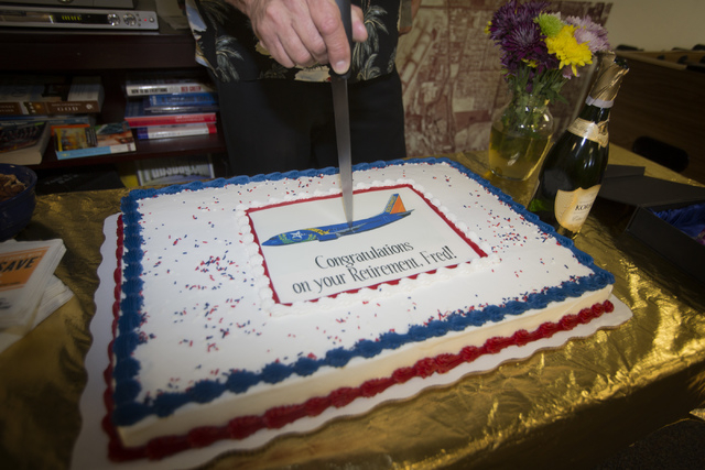 Southwest Airline  pilot Capt. Fred Sorenson cuts a cake in the pilots lounge a McCarran International Airport after making his final flight with the airlines  on Wednesday, June 11 , 2014.  Soren ...