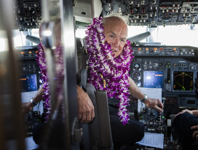 Southwest Airline  pilot Capt. Fred Sorenson sits in  the cockpit at  McCarran International Airport after making his final flight with the airlines  on Wednesday, June 11 , 2014.  Sorenson, known ...