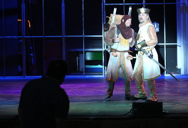 Evan Litt, left, as Patsy and Glenn Heath as King Arthur, perform as director Phil Shelbourne, left, looks on during dress rehearsal for Spamalot at Spring Mountain Ranch in Blue Diamond, Nev.  on ...