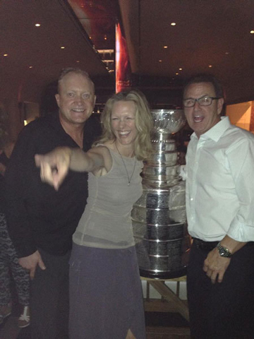 Celebrity bartender John O'Donnell and Jenna Morton, partners at Crush restaurant at MGM Grand, pose with the Stanley Cup on Thursday with MGM Grand president Scott Sibella. (Courtesy photo)
