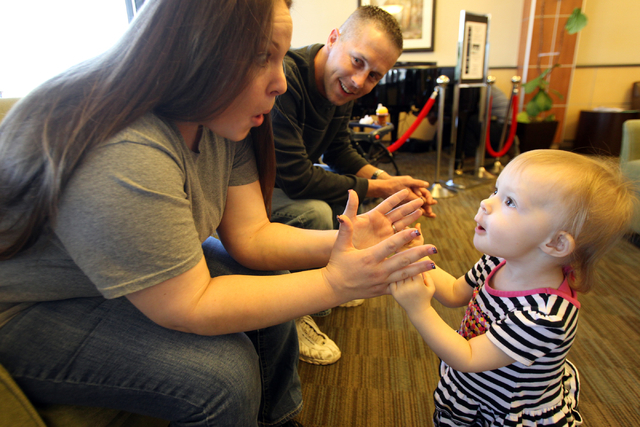 Shelli Dykens plays with her 19-month-old daughter Savannah as her husband Jerimey (cq) looks on in the lobby of Sunrise Hospital and Medical Center on Wednesday, May 14, 2014. Dykens ran over her ...
