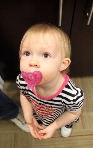 Nineteen-month-old Savannah Dykens is photographed at Sunrise Hospital and Medical Center on Wednesday, May 14, 2014. Savannah is expected to make a full recovery after her mother, Shelli Dykens,  ...