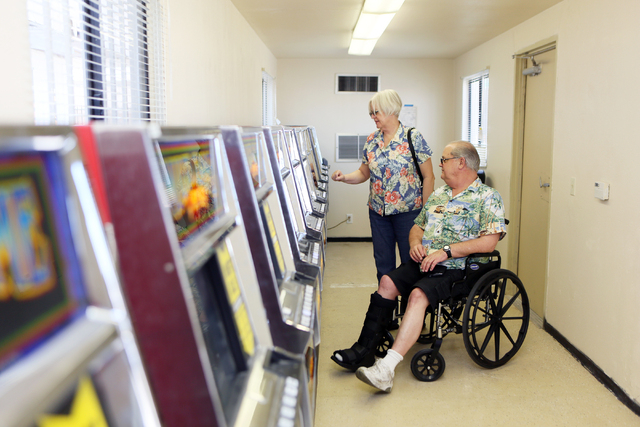 Barbara Moore and her husband Ron play a slot machine inside a modular building at Moulin Rouge, located at 900 West Bonanza Rd., Wednesday, June 11, 2014, in Las Vegas. Gaming was available for e ...