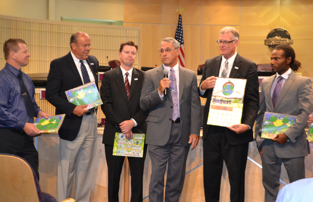 Rick Stater and employees of Tronox present donated Arbor Day calendars to the Henderson City Council during a June 17. meeting. Tronox received a special commendation from the mayor and council f ...