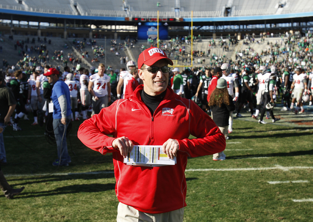UNLV head coach Bobby Hauck walks off the field after losing the Heart of Dallas Bowl in Dallas Wednesday, Jan. 1, 2014. (John Locher/Las Vegas Review-Journal)