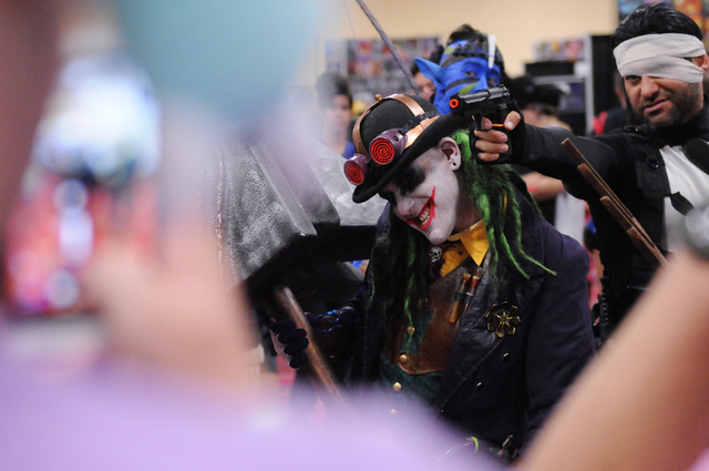 Rene Hernandez, right, in character as The Punisher, and Mike Syfritt, in character as Gaslight Joker, pose for photos during the 2014 Amazing Las Vegas Comic Con at South Point casino-hotel in La ...