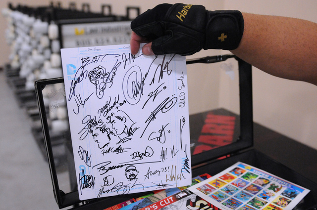 Mark Niven shows autographs he has collected from comic book artists during the 2014 Amazing Las Vegas Comic Con at South Point casino-hotel in Las Vegas Saturday, June 21, 2014. (Erik Verduzco/La ...