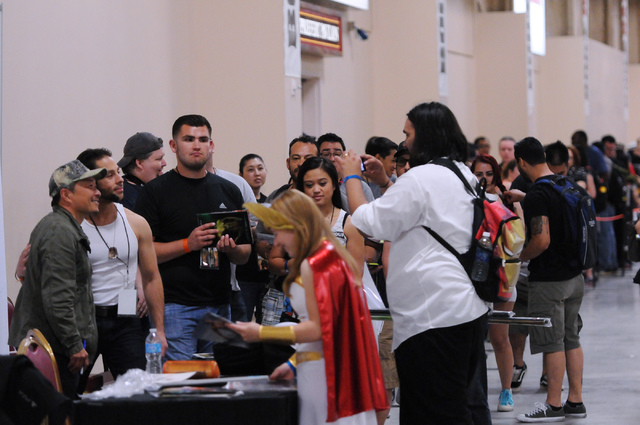 Fans wait line to meet comic book illustrator and publisher Jim Lee during the 2014 Amazing Las Vegas Comic Con at South Point casino-hotel in Las Vegas Saturday, June 21, 2014. (Erik Verduzco/Las ...