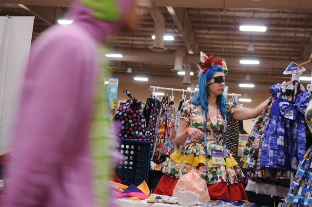 Kimberly Fisher, owner of Girl With One Eye dress shop, organizes merchandise as she waits for costumers during the 2014 Amazing Las Vegas Comic Con at South Point casino-hotel in Las Vegas Saturd ...