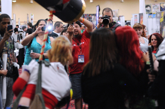 Attendees photograph people in costumes during the 2014 Amazing Las Vegas Comic Con at South Point casino-hotel in Las Vegas Saturday, June 21, 2014. (Erik Verduzco/Las Vegas Review-Journal)