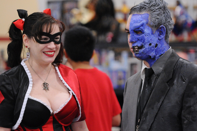 Ben Kimberlin, right, in character as Two-Face, and his wife Beth, in character as Harley Quinn, browse a comic book stand during the 2014 Amazing Las Vegas Comic Con at South Point casino-hotel i ...