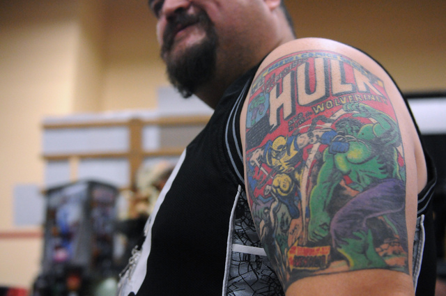 Andy Martinez shows his tattoo, The Incredible Hulk cover when Wolverine made his first appearance, during the 2014 Amazing Las Vegas Comic Con at South Point casino-hotel in Las Vegas Saturday, J ...