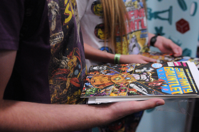 Michael Swanson, left, and his friend Amber Schaff, wait in line to get autographs from comic book illustrator George Perez during the 2014 Amazing Las Vegas Comic Con at South Point casino-hotel  ...