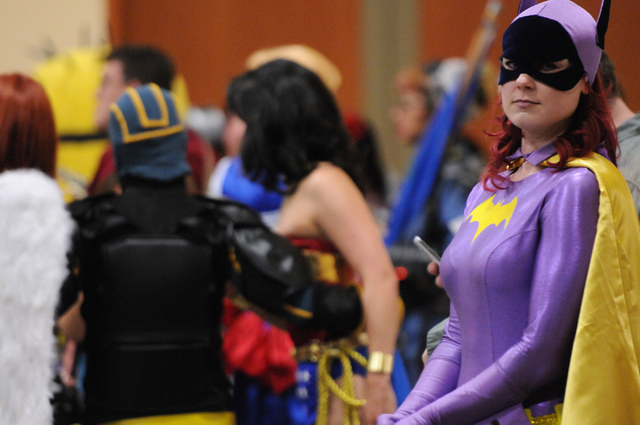 Shauna Webb, in character as 1960's Batgirl, waits in line to participate in the costume contest during the 2014 Amazing Las Vegas Comic Con at South Point casino-hotel in Las Vegas Saturday, June ...