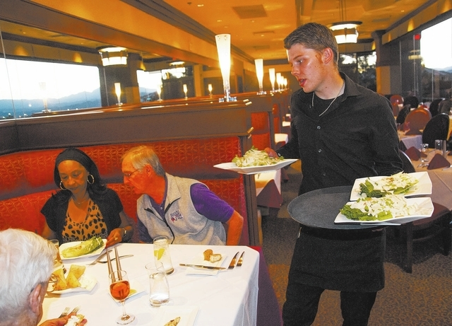 Server, Cory Quenzler, right, serves up salads to customers, at Vic's New American Cuisine, at 2450 Hampton Road, in Henderson, Nev., Saturday, October 26, 2013. (Martin S. Fuentes/Las Vegas Revie ...